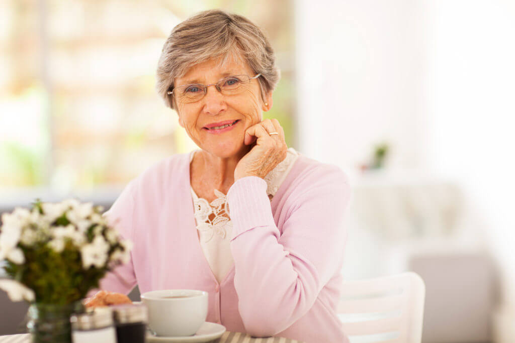 senior woman having tea